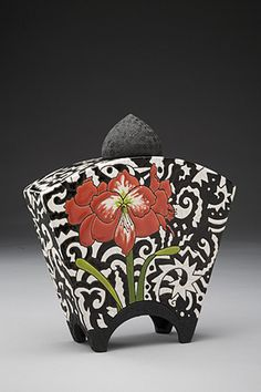 Susan Bach creates one of a kind vessels, teapots and plates. Her pieces incorporate highly decorative surfaces that reflect her ongoing fascination with patterns. She starts with slab built or wheel thrown earthenware, then a smooth white surface is decorated with under glaze imagery. She then lines the vessels with a bright glaze and coats the outside with a high gloss clear glaze. A second firing produces the brilliant shine and lovely feel of the final piece.