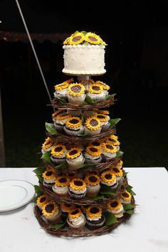 sunflowers wedding cake and cupcakes / http://www.deerpearlflowers.com/rustic-wedding-cupcakes-stands/