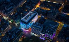 flew in a helicopter over London at dusk to capture the lights of the West End ......  this one of Leicester Square and the W Hotel...