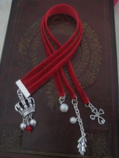 Book marker hand made by me, velvet ribon, cute charm and swarovski cristals.