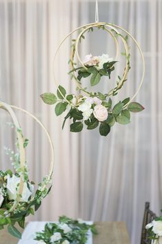 """Unique Design: Handcrafted with blush and ivory open roses, rose buds, greeneries and vines on a bentwood spheres and a orbit hoop. They look realistic and will last forever. Package & Size: Set of 2 floral hoop wreaths. The floral hoops are 12"""" diameter. Natural twine cords atteached, ready for hanging. From a lar"""