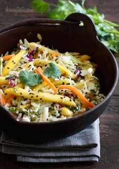 ASIAN CABBAGE MANGO SLAW. Toss together: 2 c shredded cabbage, 1/2 c shredded carrots, 1 sliced mango, 3 chopped scallions. Whisk together 3 tbs rice vinegar, 1/2 fresh lime juice, 1 tbsp low sodium soy sauce, 1 tbsp sesame oil. Pour dressing over mix and toss to coat. Allow to rest 15-20 min. Sprinkle with 1 tsp sesame seeds.