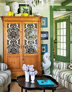 Great idea: Cover glass in an old armoire with a pretty pattern.
