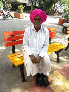 Maharashtrian gentleman in traditional dhoti & kurta wearing a fuschia feta , India