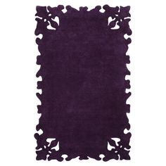 Wool rug in purple with a decorative border. Hand-tufted in India.   Product: RugConstruction Material: 100% WoolColor: PurpleFeatures:  Hand-tuftedMade in IndiaExquisite design Note: Please be aware that actual colors may vary from those shown on your screen. Accent rugs may also not show the entire pattern that the corresponding area rugs have.Cleaning and Care: These rugs can be spot treated with a mild detergent and water.  Professional cleaning is recommended if necessary.