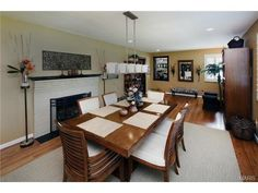 Such a cozy placement of a fireplace, right by the dining room table. 719 East Monroe Avenue, St Louis, MO 63122.