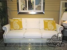 "Transitional style three seat sofa in white with silver nailhead trim and two accent pillows. What a nice, bright look! This would be a great addition to your living room or family room. 82""long x 36""deep x 35""high."