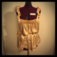 Ruffle top Cute nude color ruffle top with sag belt, size M. NWT. Can fit a L. bebe Tops Blouses
