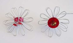 "Daisy winders and flower looms make a great jig for winding wire flowers.  These flowers were made on the one and a half inch loom from the Studio Twelve ""1000 Flowers"" set.  I used a couple of metres of 26 gauge silver coloured wire, a small button and bead."