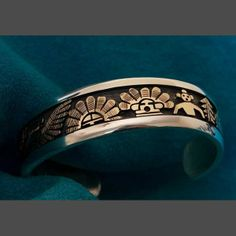 Native American Silver and Gold Bracelet Jewelry by Watson Honanie