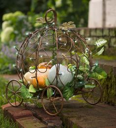 Light-Up Pumpkin Carriage Garden Planter | Turn your landscape into a modern-day fairytale with its elaborately-scrolled design. Delicate string lights twinkle against the frame, radiating a feeling of magical mystery. Show off blossoming plants or gourds day and night with convenient auto timer that turns lights on for 6 hours, off for 18.