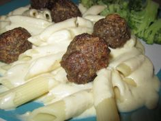 Parmesan Meatballs & Alfredo... Way better than jarred Alfredo Sauce and easy to make. Find this recipe and more at Chicky's Cafe & Bowtique.