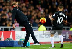 Jurgen Klopp, manager of Liverpool attempts to control the ball for Philippe Coutinho of Liverpool during the Barclays Premier League match between Sunderland and Liverpool at Stadium of Light on December 30, 2015 in Sunderland, England.