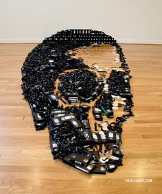"A skull made with 497 VHS videotapes by Noah Scalin founder of skull-a-day. This project was commissioned by TCC Visual Arts Center to create this new installation called ""Dead Media"". Crane, Visual Arts Center, Shape Art, Vhs Tapes, Cassette Tape, Skull Design, Skull And Bones, Skull Art, Up Girl"