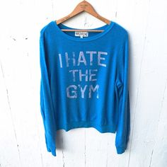 """WILDFOX I Hate the Gym Soooo soft + cozy! If you own any WILDFOX you know what I'm talking about when I say amazing fabric. Cute graphic scoop neck sweater in a matte blue delicate knit fabric. Stylish seams on sleeves. Approximately 25"""" in length. Machine wash cold.  ✧ fits true as a loose medium ✧ made in the USA ✧ NO TRADES, sorry ladies! ✧ 47% polyester • 47% cotton • 6% spandex  * I wear a size small for reference Wildfox Sweaters Crew & Scoop Necks"""