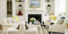 What a great palette for a Hamptons style home using grey and yellow as accent colours. The striped rug is also a great choice echoing the striped blue and white rug made famous by the 'Something's gotta give' living room