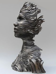 "Australian artist Gil Bruvel creates fascinating figurative sculptures using bands of stainless steel ribbons.  ""I am very passionate about my current expression - Flow Series. It is the culmination of my life"