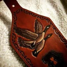 custom leather rifle sling destined for a heavy barrel rifle featuring two canadian geese at the top.  by Appaloosa Leather
