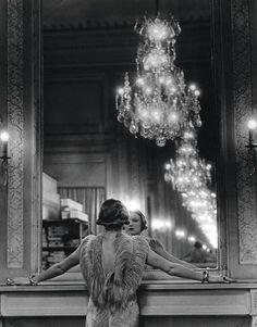 Alfred Eisenstaedt. Model Looking in the Mirror of Fashion Designer Molineux, Paris.
