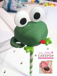 Kiss me I'm Irish Frog Cakepop.  The body is made with My Little Cakepop's heart shaped cake pop mold.  Lime green stars and pretzels for feet.  Large eyes and a red confetti dot for a mouth. www.MyLittleCakepop.com
