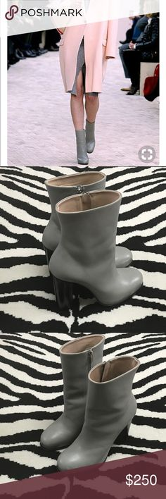 Celine Boots Celine Gray Boots. Stacked heel, side zip great neutral shoe. Some signs of wear. Scuffing on toe, light markings on heel. Easy touch up for a cobbler. Celine Shoes Heeled Boots