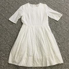 Gap white eyelet dress Gap white eyelet material dress. Size 8. Pockets. Zip back. 36 inches from shoulder to hem. Only worn ONCE for pictures with my daughters. A little wrinkled from wash but could easily be ironed. Clean smokefree home. GAP Dresses Mini