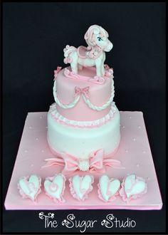 Baby Girls pink 2 tier Christening cake with handmade rocking horse figure