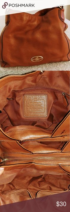 Coach Shoulder Bag Fairly used, could due well with a good cleaning. It's just  been taking up space in my closet it could still serve someone well! Has a few marks or stains that could be cleaned or just to point them out see pictures. Coach Bags