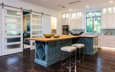 Contemporary Kitchen with Breakfast bar, Glass panel, Flat panel cabinets, Farmhouse Sink, Barn door, Limestone counters