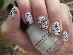 --cute  doodles  white base  light blue  probably a sharpie or nail art pen