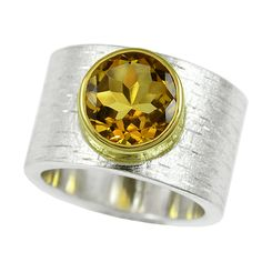 size: 7  width: 13mm  metal: sterling silver with 14k yellow gold bezel  center stone: 3.09ct AAA natural citrine