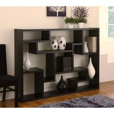 @Overstock - Materials: Wood, veneer, MDF Finish: Black Versatile displayhttp://www.overstock.com/Home-Garden/Enitial-Lab-Mandy-Bookcase-Room-Divider/6237785/product.html?CID=219666 $239.99