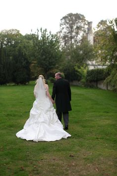 Bride and groom take a country walk