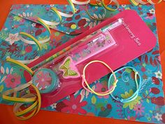 We fill a stunning A4 size vinyl flower and butterfly wallet (which has a secure popper fastening) with a matching 5 piece stationery set which includes a ruler, pen, pencil, eraser and pencil sharpener. There are also two rainbow friendship bracelets. £2.40