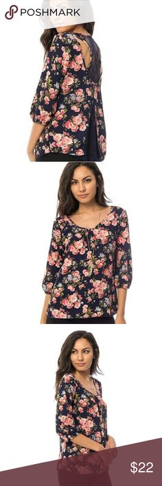 Navy floral lace racer-back blouse with necklace Gorgeous Navy blue and pink floral blouse, the perfect casual yet trendy piece. Add some distressed jeans and flats or a casual day or some slacks and high heels for business attire. Features a detailed cutout back with a lace, pleated racer-back to add some flare! Also includes a trendy detachable necklace!  95%Polyester 5%Spandex Made in USA Tops Blouses