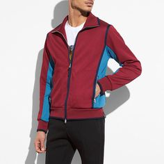 A throwback to vintage '70s styles, this cotton track jacket is made modern with a relaxed, yet slimmer fit.  It's detailed with front zip-pockets, contrasting accents and sporty piping. Pair it with the matching track pants for a cool retro look.