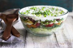 Making a seven layer salad is easy and delicious!  It's the perfect dish to bring to any cookout or to serve on your table any night of the week.