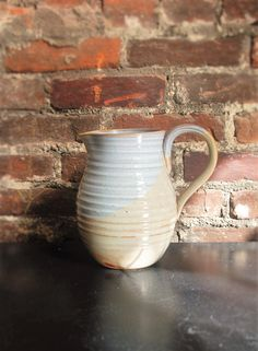 A personal favorite from my Etsy shop https://www.etsy.com/listing/125358993/pitcher-neutral-creamwhite
