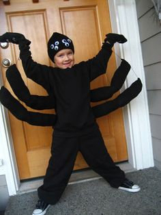 Spider costume - stuff and sew black socks to create the extra legs.  Glue googly eyes onto knit cap.