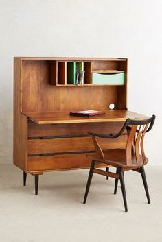 Writing Desk - The retractable Writing Desk from fashion and home retailer Anthropologie features a retro, natural wood design that is accented with colored wood . Vintage Furniture, Cool Furniture, Furniture Design, Hutch Furniture, Bedroom Furniture, Luxury Furniture, Wooden Furniture, Furniture Makeover, Furniture Ideas