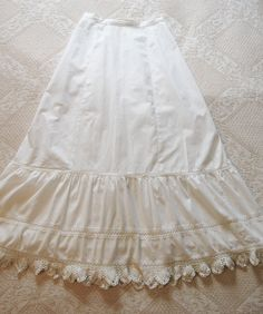 Floor length double ruffle Victorian ladies cotton petticoat with crochet trim and ruffled edge.