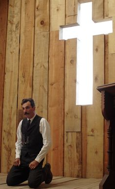 Daniel Plainview on his knees in There Will Be Blood