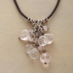 """BLUSHING BUBBLES NECKLACE--A pink rose quartz necklace, in which a cluster of the pale gemstone blushes amid tiny sterling rings, strung on a leather cord with sterling silver toggle closure. Exclusive. 17""""L."""