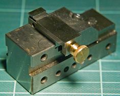Miniature tilting and swiveling vise held in toolmakers mini vise - these are tiny vises
