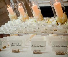 Place cards held with wine corks are arranged on a table covered with petals.