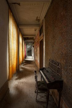 An organ in the corridor of an abandoned chateau in France [1024x683] [OC]