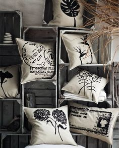 Grey, cream and black instantly create a theme for this pillow collection - wooden crate prop for craft fair.