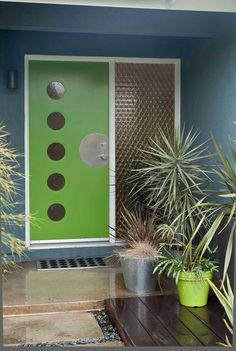 The green door and potted plants make this mid-century modern inspired entrance pop. Great outdoor space.