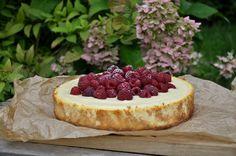 goat cheese cheesecake with white chocolate and raspberries