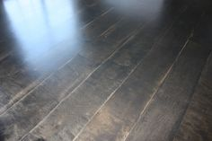 """Plywood flooring: 1/4 birch veneer plywood cut into 12 inch wide planks and stained with Minwax Ebony. Tutorial by Erin Westrate at """"All Quiet on the MidWestern Front"""" blog."""